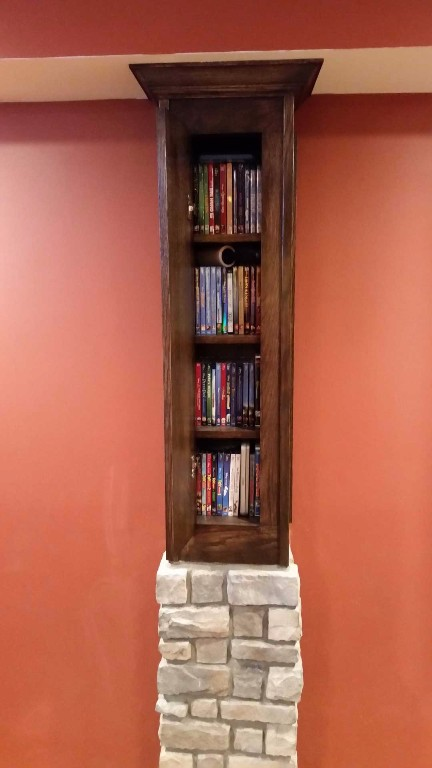 Custom wood and stone column with integrated book shelf
